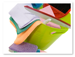 picture of green bucket with various colored micro-fiber towels used for green cleaning